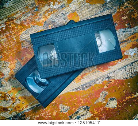 Two video cassette close-up on a wooden surface retro-style old record sound and images