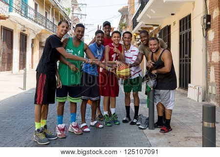 SANTO DOMINGO, DOMINICAN REPUBLIC - CIRCA JAN 2016: Unidentified basketball fans posing for a photo in Santo Domingo, Dominican Republic.