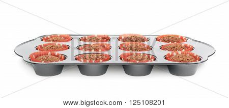 Metal muffin tray pan filled with the cooked ready to eat cupcakes, composition isolated over the white background