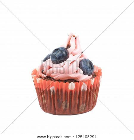 Single chocolate muffin coated with the pink cream frosting and fresh bilberries, composition isolated over the white background