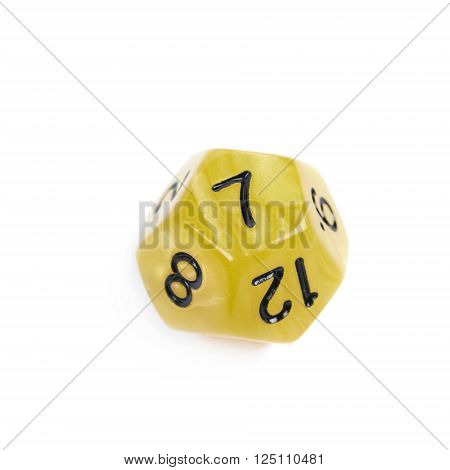 Yellow roleplaying polyhedral dodecahedron gaming plastic dice isolated over the white background