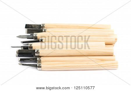 Pile of hand carving wood chisel tools, composition isolated over the white background