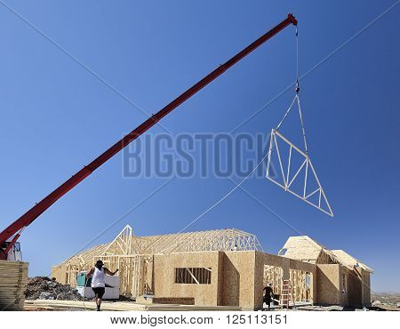 man working tag line construction home building industry carpentry and sitework details in progress