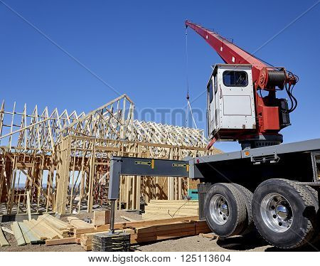 crane setting roof trusses construction home building industry carpentry and sitework details in progress