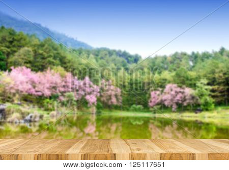 Wood table top on blurred landscape in doi Inthanon background summer concept - can be used for display or montage your products