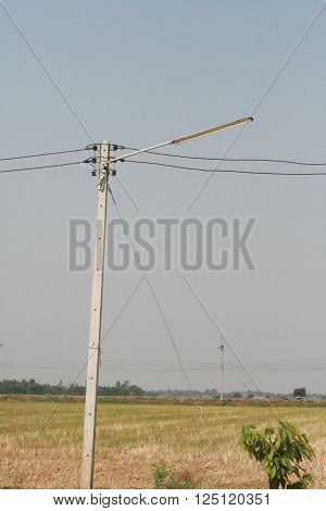 Electric pole with dim light in rural scene