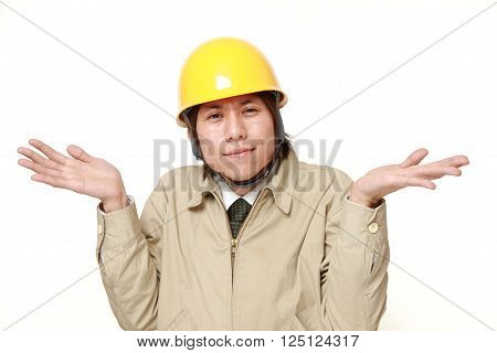 portrait of Japanese construction worker confused on white background