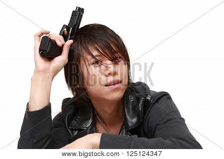 man with a handgun thinks on white background