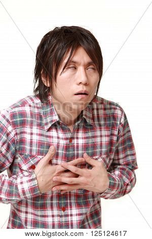 portrait of young Japanese man heart attack