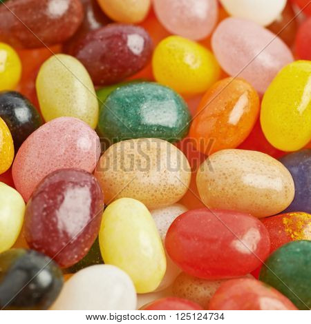 Surface covered with multiple colorful jelly bean candies as a backdrop composition ** Note: Shallow depth of field