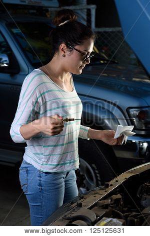 Girl Checking Oil Level