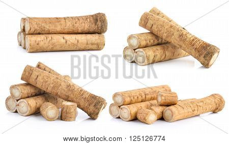Fresh Burdock roots on the white background