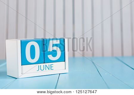 June 5th. Image of june 5 wooden color calendar on white background. Summer day, empty space for text. International Cleanup Day.