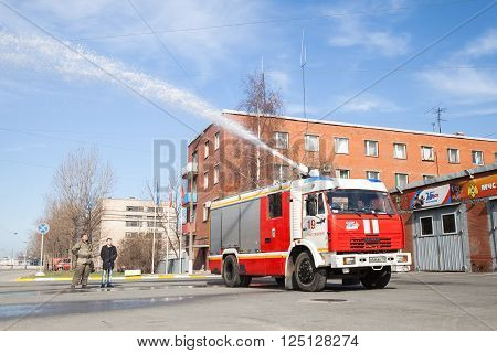 St. Petersburg, Russia - April 9, 2016: Kamaz 43253 truck as a Russian fire engine modification with a running hose