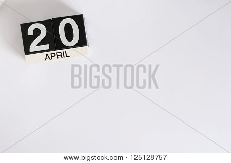 April 20th. Cannabis Day. Image of april 20 wooden color calendar on white background.  Spring day, empty space for text.  Secretary's DAY.