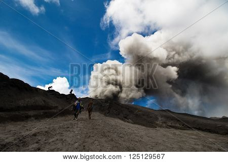 Java Indonesia - April 3 2016: Many tourists Travel to Mount Bromo Mount Bromo is an active volcano and part of the Tengger massif in East Java Indonesia. At 2329 metres.