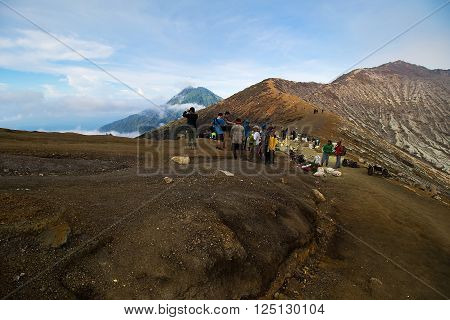 Java Indonesia - April 4 2016: Many tourists travel to Kawah Ijen Vacano. The Ijen volcano complex is a group of stratovolcanoes in the Banyuwangi Regency of East Java Indonesia.