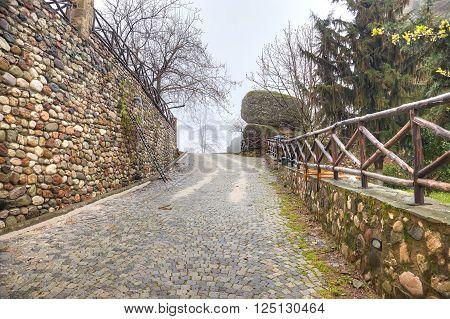 Greece. Meteora. Monastery on a rock. Road