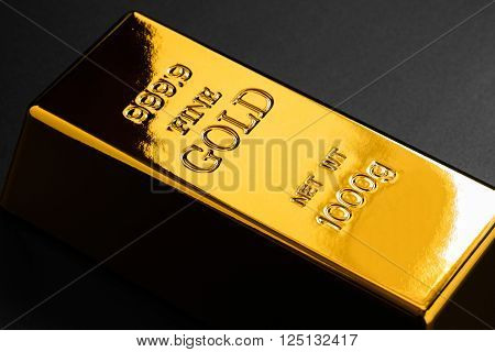 closeup of gold bullion on a dark background
