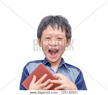 Asian boy laughing between reading a book over white background