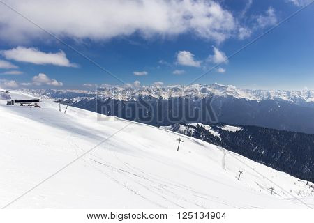 Scenery mountain top view from Rosa Peak with cable ski elevator