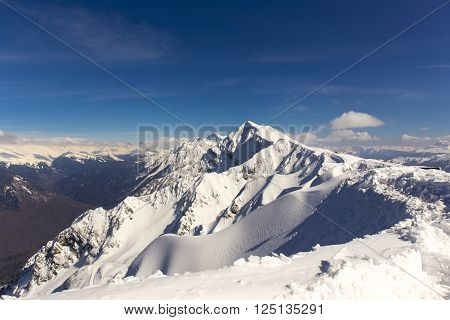 Scenery top view from Rosa Peak on snowy Caucasus mountains