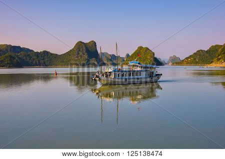 Tourist boat among the islands in Halong Bay.
