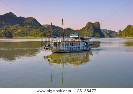 Commuter ship among the islands in Halong Bay.