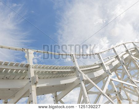 beautiful abstraction of a white wooden structure of the old road leaving in the blue sky with white cumulus and cirrus clouds