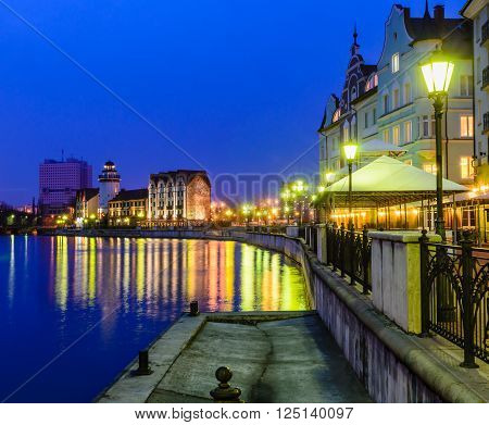 KALININGRAD, RUSSIA - March 7: Ethnographic and trade center, embankment of the Fishing Village, night view in March 7, 2015 in Kaliningrad, Russia.