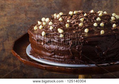 Chocolate cake three layers with dark and white chocolate topping.