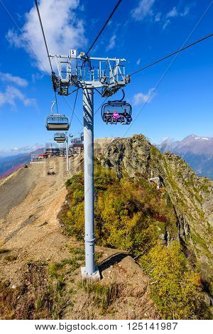 SOCHI, RUSSIA - October 8: People on the cable car in the scenic mountains at the autumn, in October 8, 2015, in Sochi, Russia.