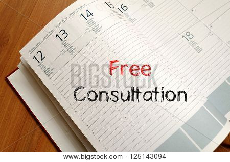 Free consultation text concept write on notebook