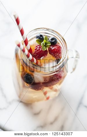 Summer refreshing drink with fruit variety, white sangria