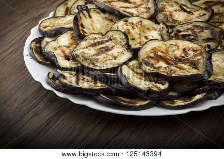 Aubergines eggplants and slices grilled on the plate