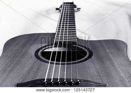 Black and white closeup of classic guitar