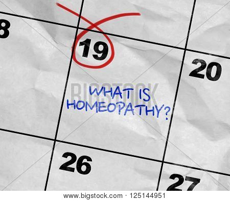 Concept image of a Calendar with the text: What is Homeopathy?