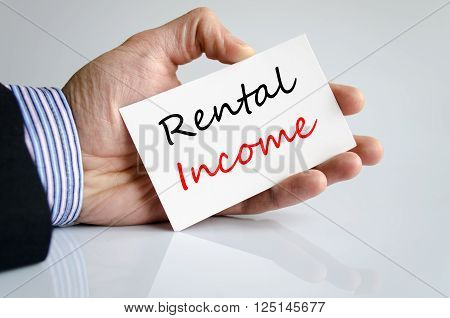 Rental income text concept isolated over white background