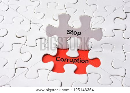Stop Corruption concept on missing puzzle with red background
