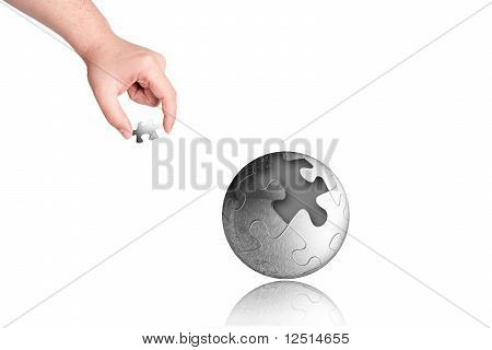 business concept with a hand completing puzzle