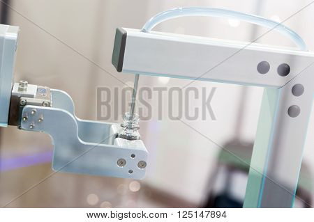 Robot Mechanical Arm With Chemical Tubes In A Medical Laboratory