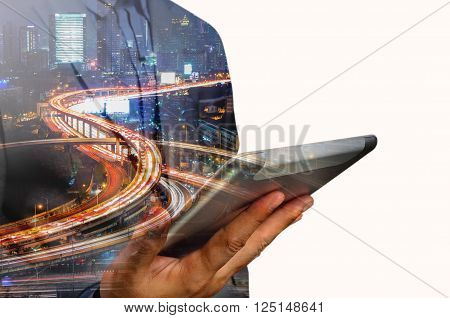 Double Exposure Of Business Man Use Mobile Tablet With Urban City Scenic