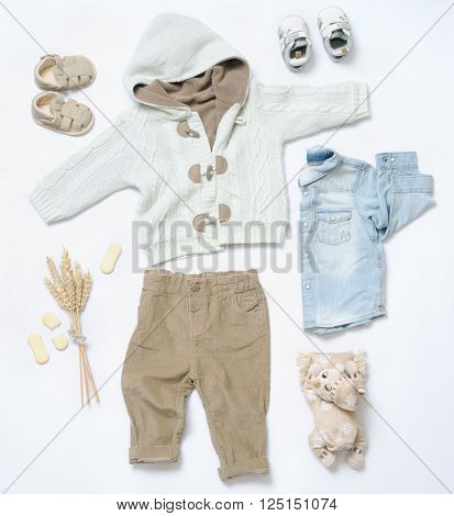 top view fashion trendy look of baby clothes and toy stuff, baby fashion concept