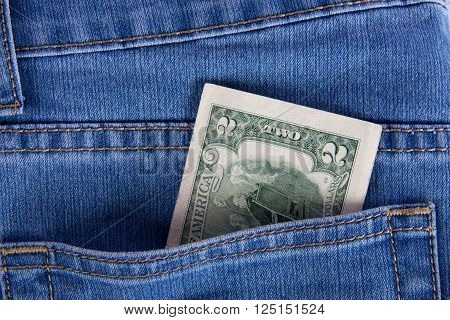 2 dollars in a pocket of jeans