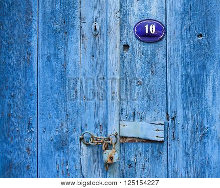 Old blue wooden front door with 10 number