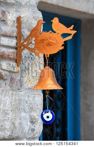 The old bird-bell that hung on the door