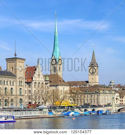 Zurich, Switzerland - 10 April, 2016: well-known buildings of the city: Stadthaus, Fraumunster, St. Peter Church. Zurich is the largest city in Switzerland and the capital of the Swiss canton of Zurich.