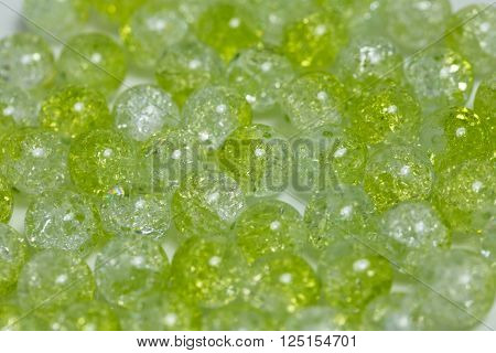 Background of rounded bright green quartz stones ** Note: Shallow depth of field