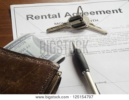 The Rental Agreement With Money And Pen