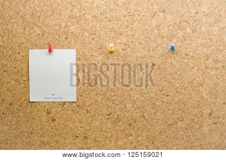 Paper card posted on a cork board with tack pin and waiting paper cards for the other tack pins
